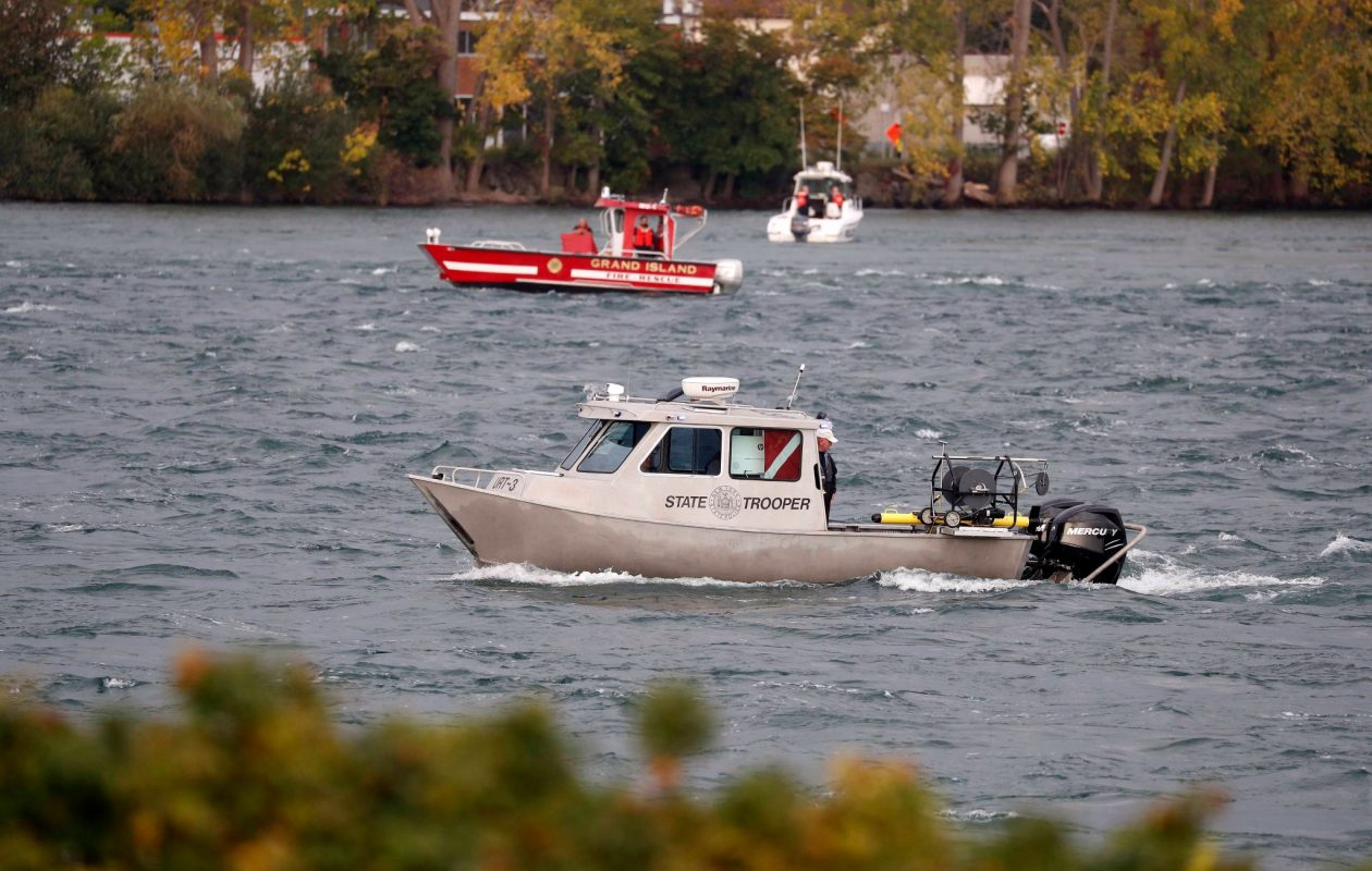 Law enforcement officials continue their search on Sunday, Oct. 15, 2017, for Buffalo Police Officer Craig Lehner, who went missing during a diving training exercise in the Buffalo River on Friday afternoon. (Mark Mulville/Buffalo News)
