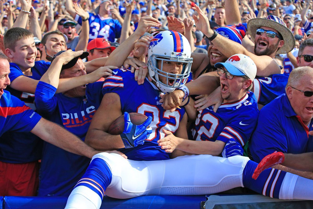 Logan Thomas celebrates his touchdown against Tampa Bay last Sunday by jumping into the stands with Bills fans. (Harry Scull Jr./Buffalo News)