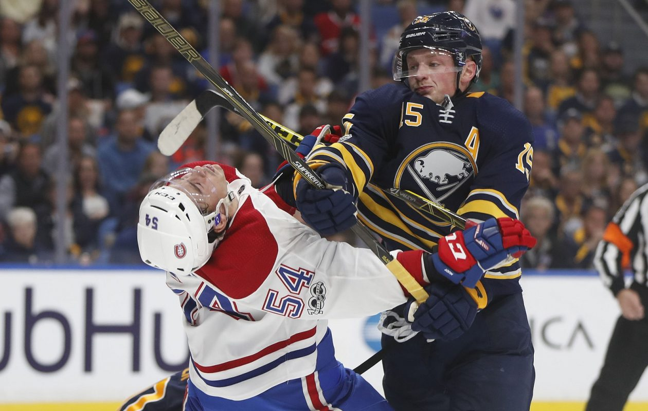 The Sabres Jack Eichel takes out Canadian Charles Hudon in the second period at the KeyBank Center Thursday. (Mark Mulville/Buffalo News)