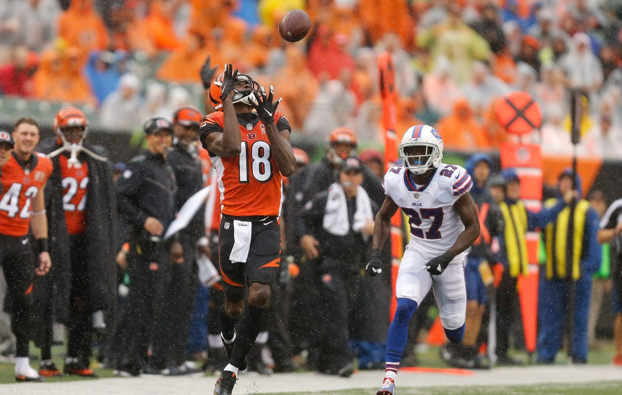 A.J. Green of the Cincinnati Bengals catches a 77-yard pass and runs it in for a touchdown while being defended by Tre'Davious White of the Buffalo Bills during the first quarter.  (Getty Images)
