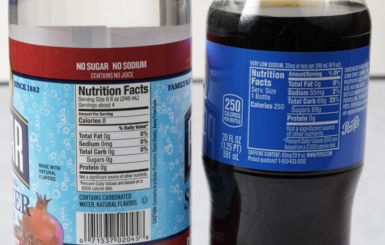 These labels don't lie. Seltzer water, on the left, is considerably healthier than this 20-ounce bottle of Pepsi, which includes 69 grams of sugar. If needed, you can add fruit slices to the seltzer to improve its taste.  (Derek Gee/Buffalo News)