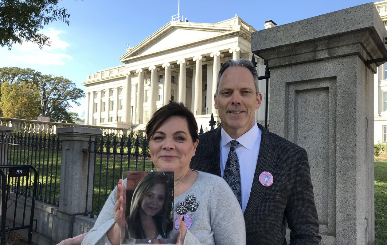 Dr. Thomas G. White and his wife, Sandra, in front of the Treasury Building in Washington Thursday after leaving the White House event where President Trump declared the opioid crisis a national health emergency. They brought with them a photo of their daughter, Hilary, who died of an opioid overdose in August. (Jerry Zremski/Buffalo News)