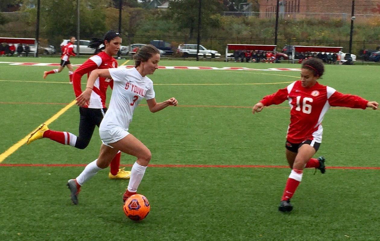 D'Youville midfielder-forward Brittany Cristofanello, in white, surges forward on a first-half counter attack. (Ben Tsujimoto/Buffalo News)