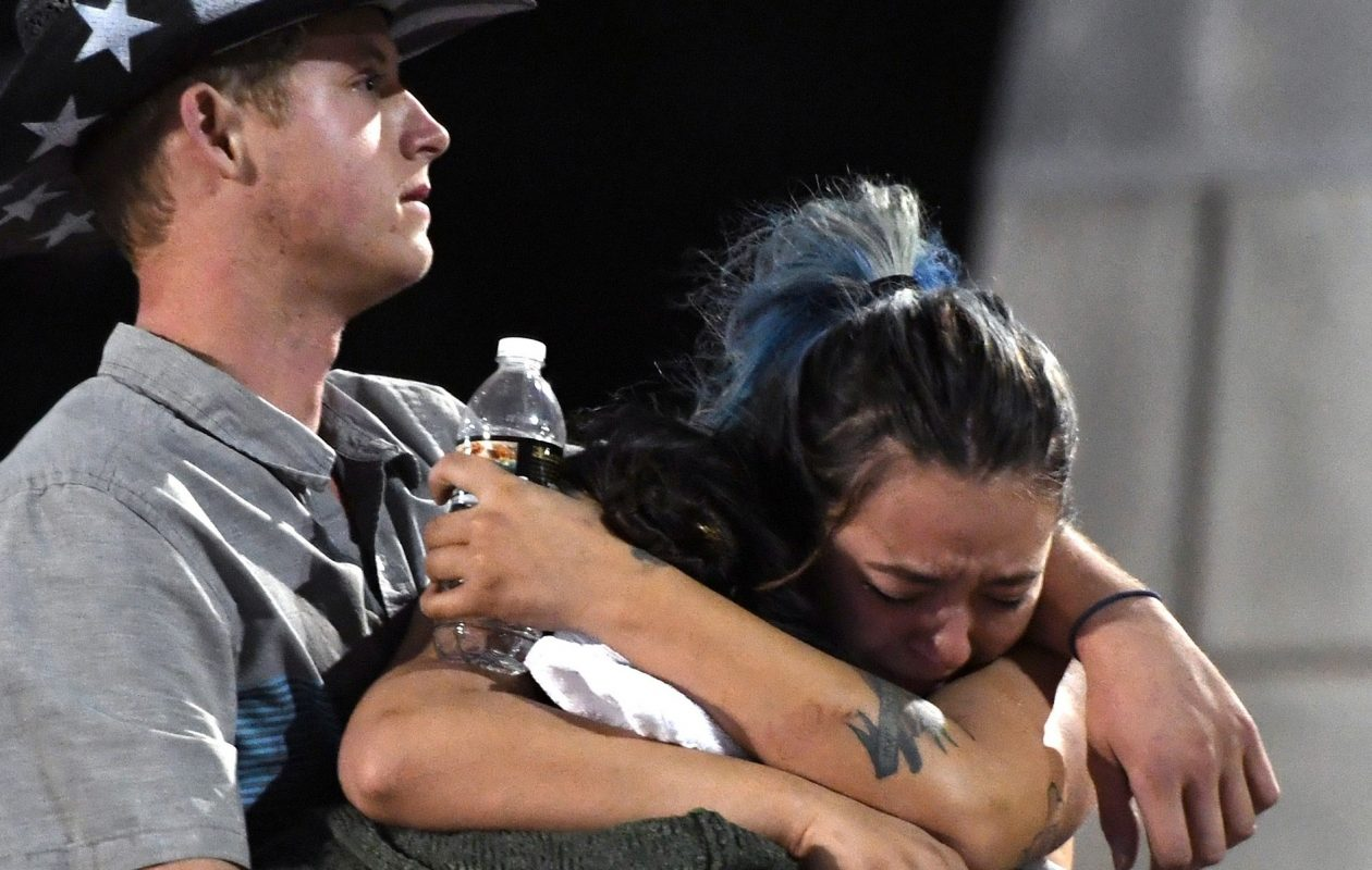 People hug and cry outside the Thomas & Mack Center after a mass shooting at the Harvest country music festival on October 2, 2017, in Las Vegas. (Getty Images)