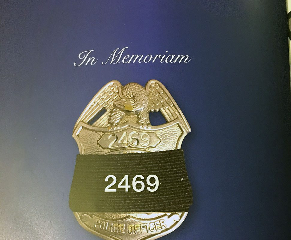 An image of Buffalo Police Officer Craig E. Lehner's shield in the funeral service program.