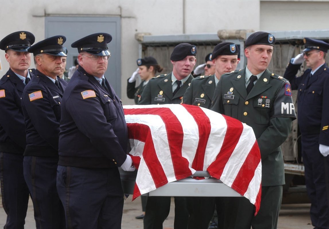 Craig Lehner, in center on right, helps carry the flag-draped casket of his friend, Spc. Michael Williams, of Buffalo, who was killed Oct. 17, 2003 in Iraq, as a member of the 105th Military Police. Lehner, who was in the Army National Guards 105th Military Police unit with Williams, later became a Buffalo police officer. His body was recovered from the Niagara River on the 14th anniversary of Williams' death, on Oct. 17, 2017. (File photo by Derek Gee / The Buffalo News)