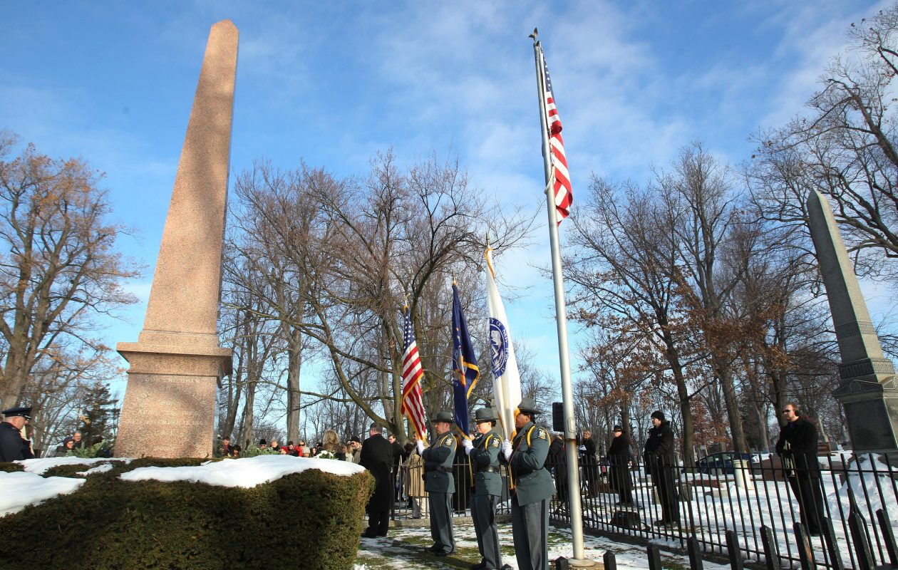 A small crowd gathered at the site of former President Millard Fillmore's grave at Forest Lawn Cemetery in Buffalo on his birthday, on Jan. 7, 2013. {Sharon Cantillon / Buffalo News}
