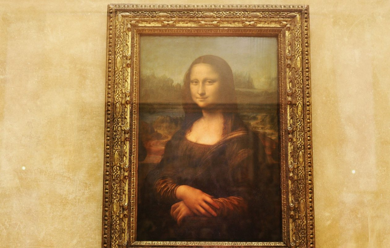 """The famous Leonardo Da Vinci painting """" The Mona Lisa,"""" on display in the Grande Galerie of the Louvre museum in Paris. (Pascal Le Segretain/Getty Images)"""