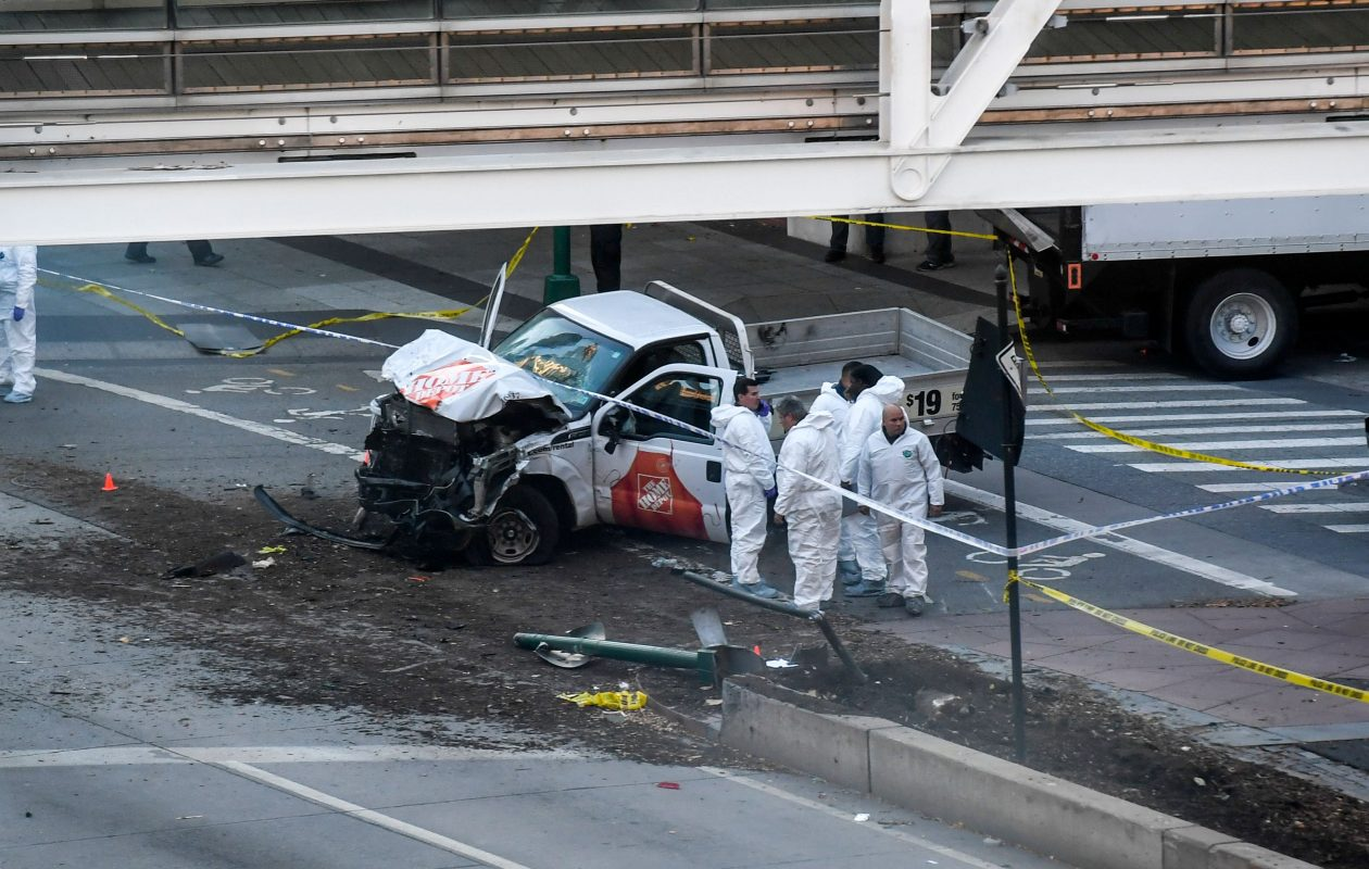Investigators inspect a truck following a shooting incident in New York on October 31, 2017.  Several people were killed and numerous others injured in New York on Tuesday when a suspect plowed a vehicle into a bike and pedestrian path in Lower Manhattan, and struck another vehicle on Halloween, police said. A suspect exited the vehicle holding up fake guns, before being shot by police and taken into custody, officers said. The motive was not immediately apparent. (/Getty Images)