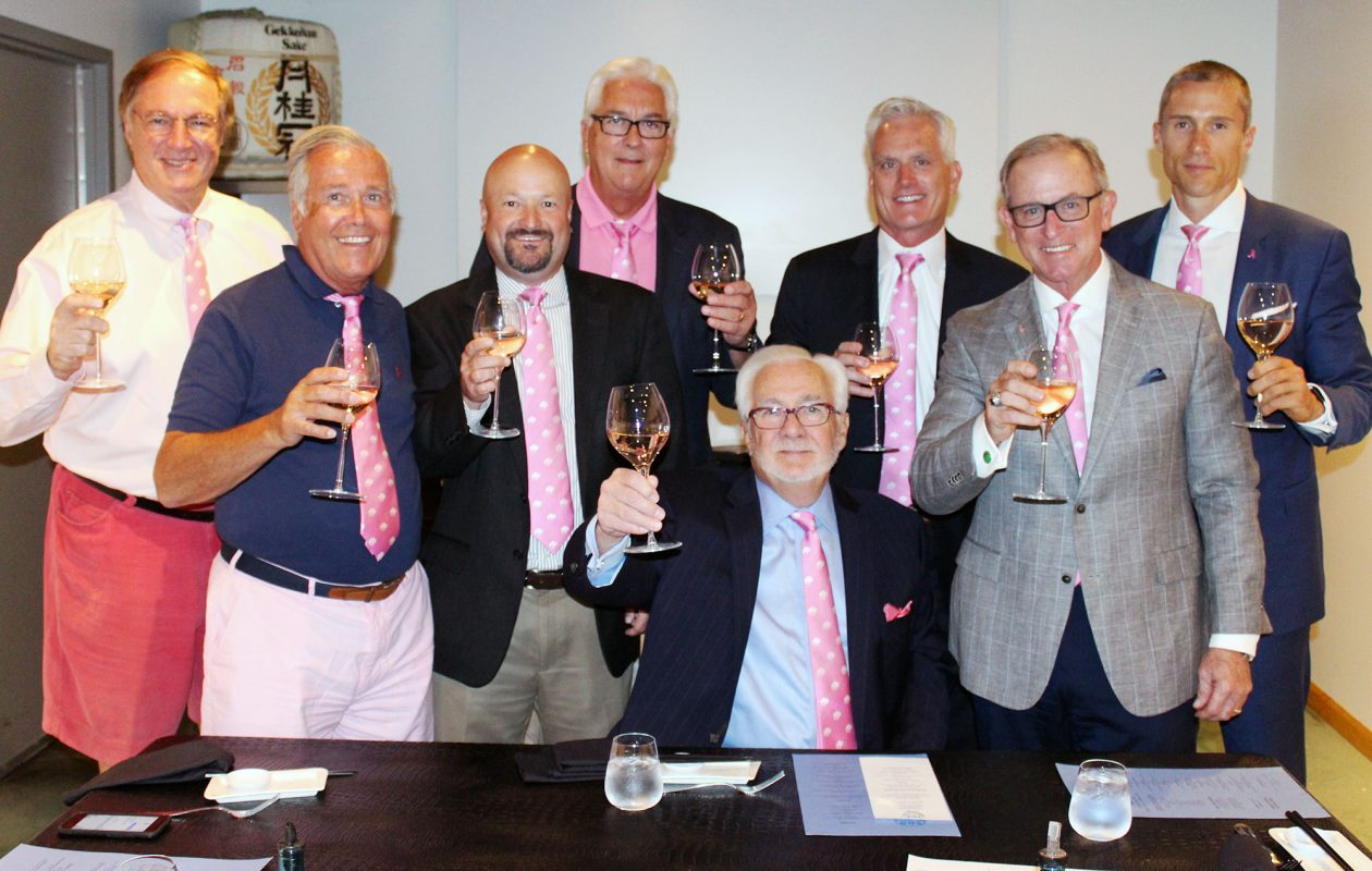 """Left to right: """"Pink Tie Guys"""" Tony Masiello, Rocco Termini, Justin Reid, Jack Quinn, Warren Colville, Mark Hamister, Dave Anderson and Kurt Fetter joined forces for a Rosé wine tasting at Seabar to promote breast  cancer awareness."""