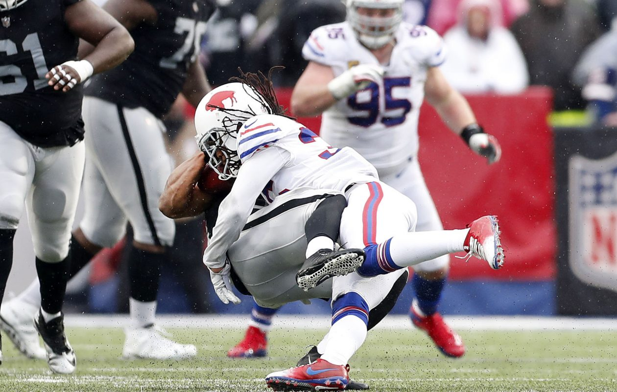 Buffalo Bills' Trae Elston puts a big hit on Oakland Raiders DeAndre Washington. (Mark Mulville/Buffalo News)
