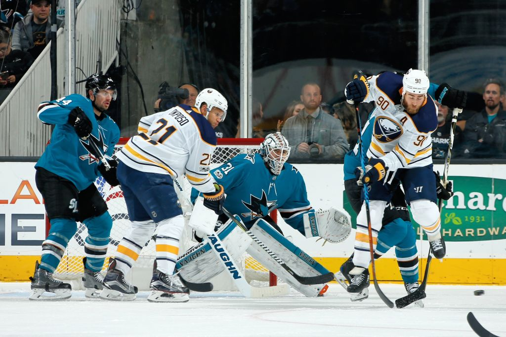 Ryan O'Reilly (90) and Kyle Okposo (21) try to create traffic in front of San Jose goalie Martin Jones Thursday night during the Sabres' 3-2 loss. (Getty Images)