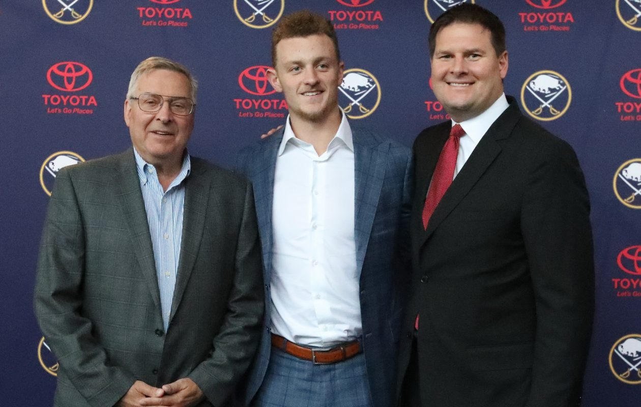 Terry Pegula, Jack Eichel and Jason Botterill are all smiles as Eichel's new deal was announced Wednesday. (James P. McCoy/Buffalo News)