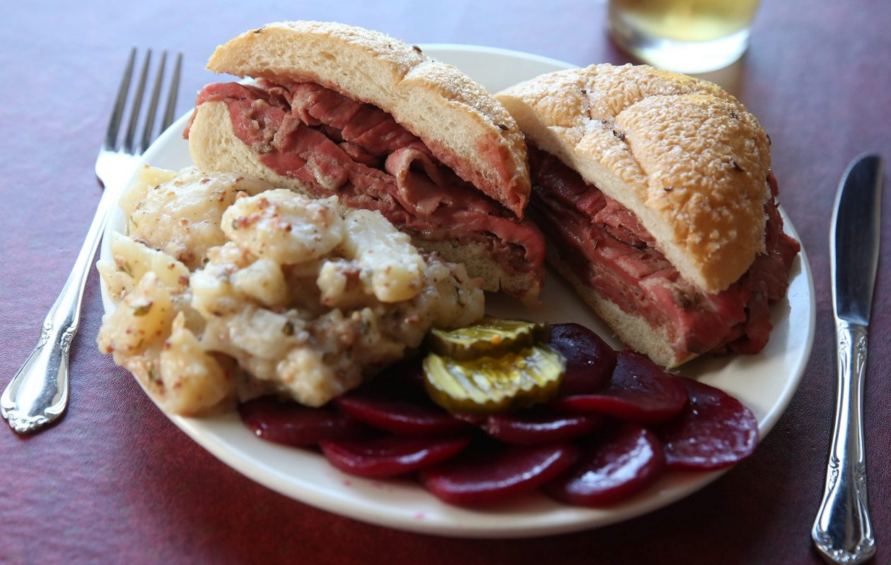 Schwabl's is participating in Local Restaurant Week and featuring its roast beef special on kummelweck. It is served with a choice of side, this having the pickled beets and German potato salad. (Sharon Cantillon/Buffalo News)