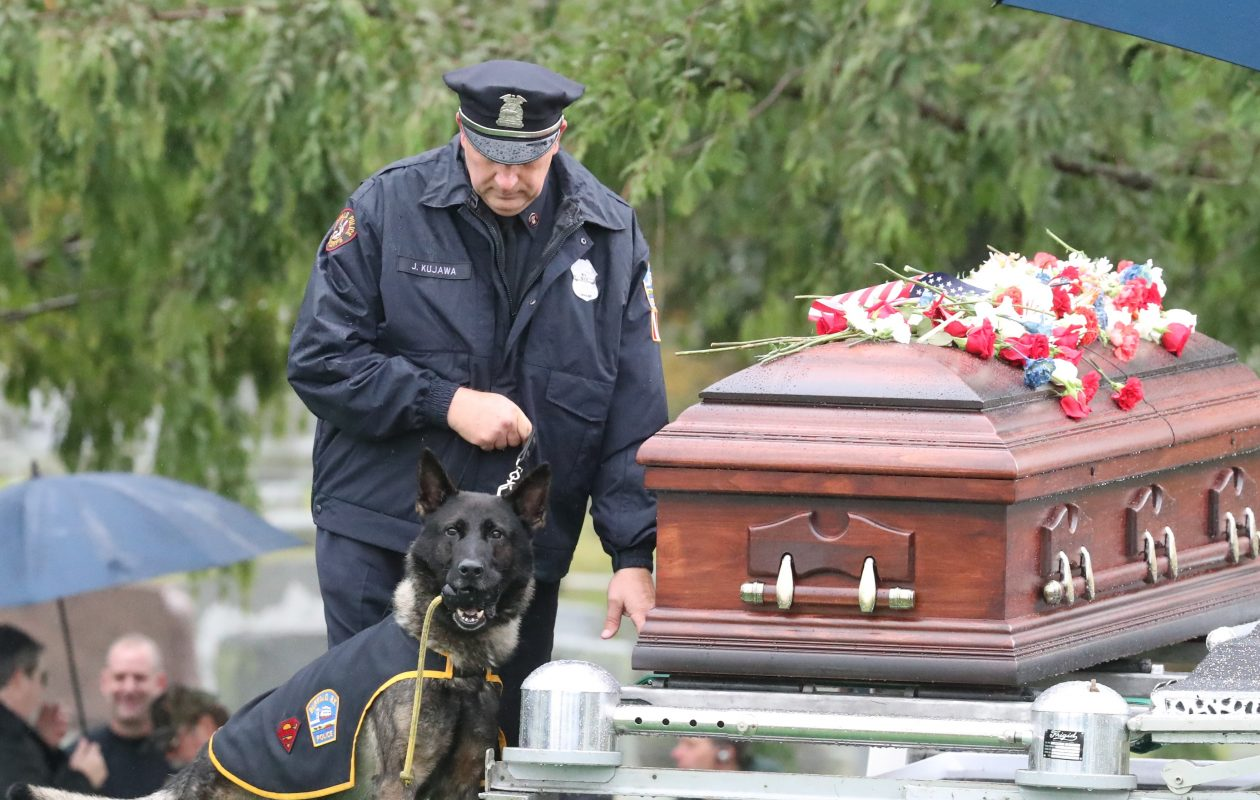 Shield says goodbye to his master and friend Buffalo Police officer Craig Lehner at Forest Lawn in Buffalo on Wednesday, Oct. 25, 2017.  (James P. McCoy / Buffalo News)