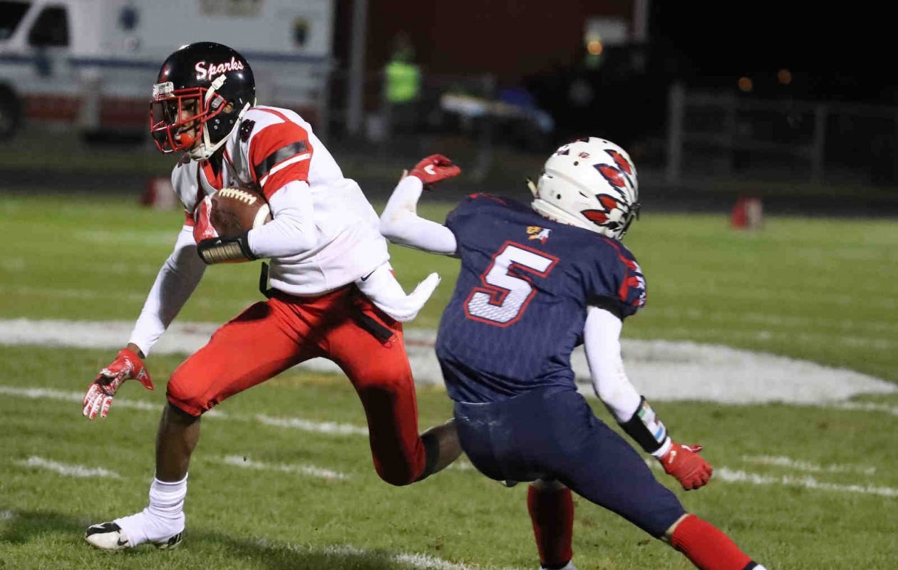 South Park's Dayquan Anderson fakes out Iroquois' Cody Collins for a first down in the first quarter of a 36-28 win. (James P. McCoy/Buffalo News)