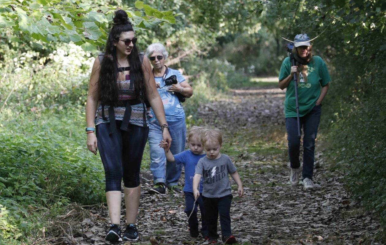 Megan Turchiarelli, of Buffalo walks with her twin sons Thomas, 2 center, and Trace, through Tifft Nature Preserve. (Sharon Cantillon/Buffalo News)