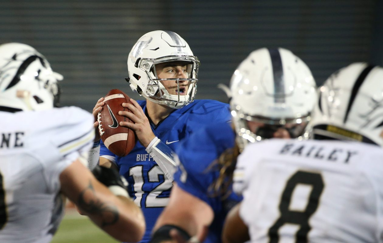 UB quarterback Drew Anderson looks for a receiver then has to scramble during a two point conversion attempt during the 6th overtime. (Sharon Cantillon/Buffalo News)