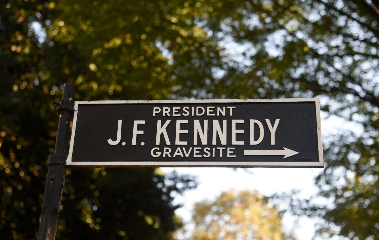 A signn near President John F. Kennedy's grave at Arlington National Cemetery Friday, Oct. 27, 2017 in Arlington, Va. After nearly 54 years of speculation and conspiracy, the US National Archive has published nearly three thousand previously top-secret documents that shine a light on John F Kennedy's assassination. (Olivier Douliery/Abaca Press/TNS)
