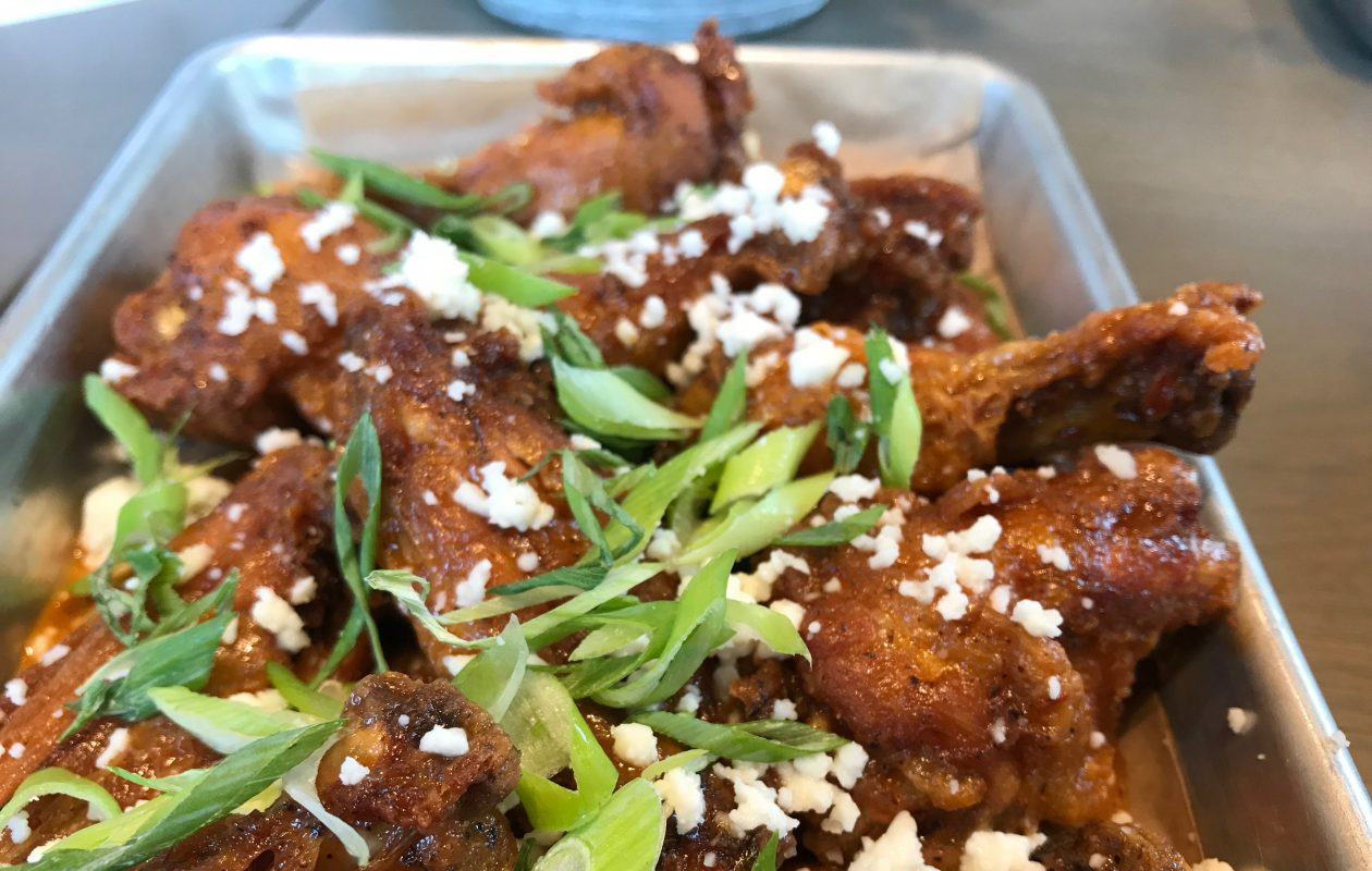 The Santa Fe wings ($8) from Bar 1818 inside Whole Foods. (Caitlin Hartney/Special to The News)