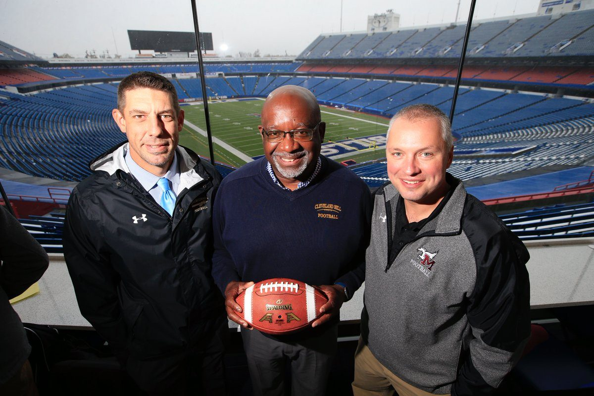 Cheektowaga's Mike Fatta, Cleveland Hill's Glen Graham and Maryvale's Jeff Buccieri share a moment during Section VI football Media Day at New Era Field on Tuesday. (Harry Scull Jr./Buffalo News)