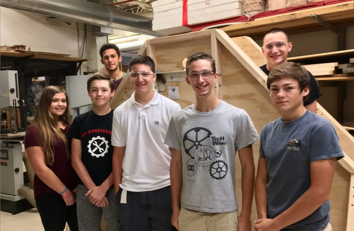 Clarence High School's Engineering Club stands with their trebuchet for the 12th Annual Trebuchet Contest on Sunday.