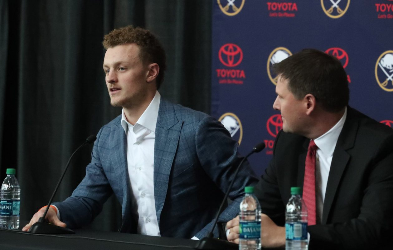 Jack Eichel and Jason Botterill are both happy the center will in Buffalo for the next nine years. (James P. McCoy/Buffalo News)