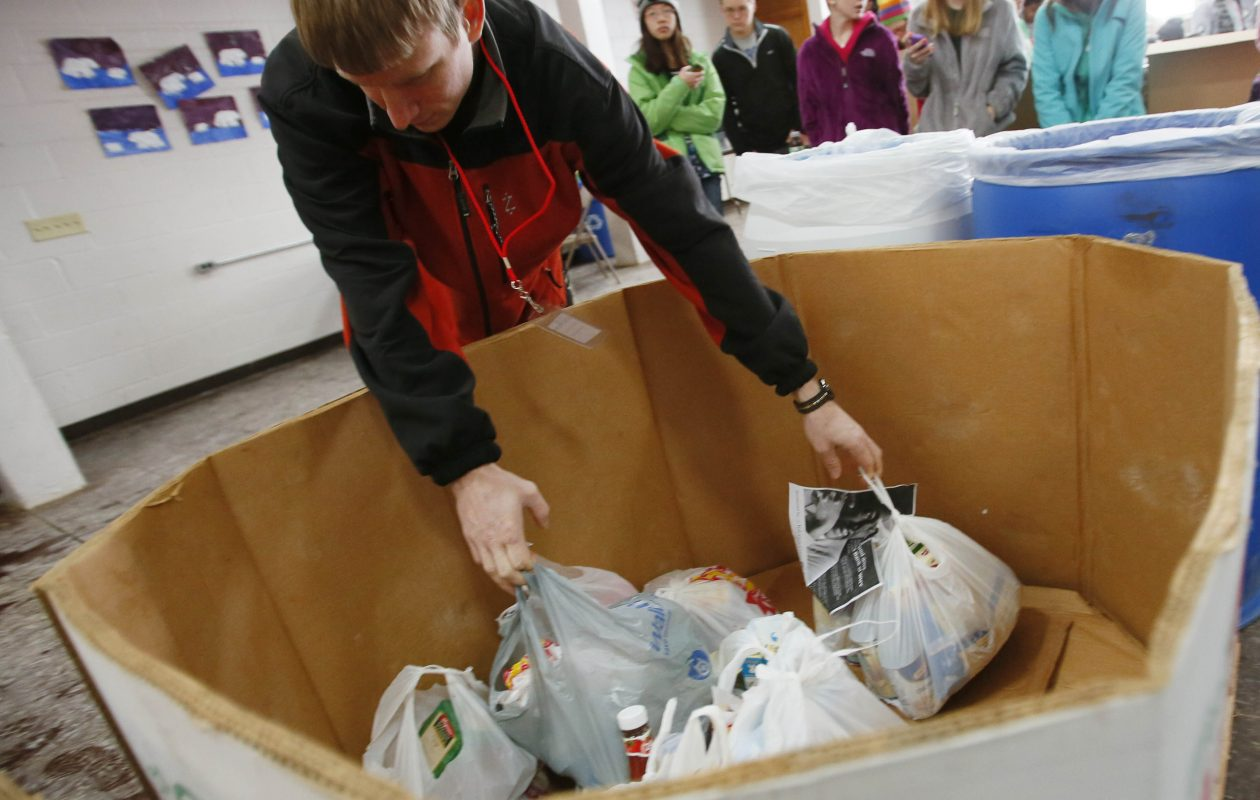 Donations are dropped off to a collection for the Food Bank of WNY in 2013. (Derek Gee/ Buffalo News file photo)