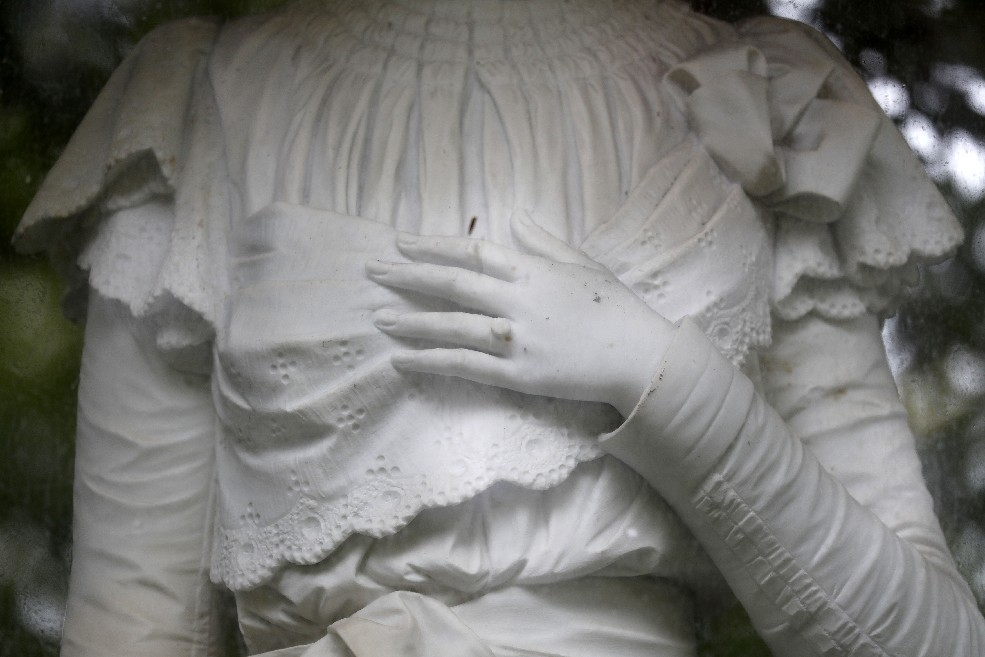 The detail on a statue of Grace Galloway at Jamestown's Lake View Cemetery created legends that the statue is actually Grace herself. (Mark Mulville/The Buffalo News)