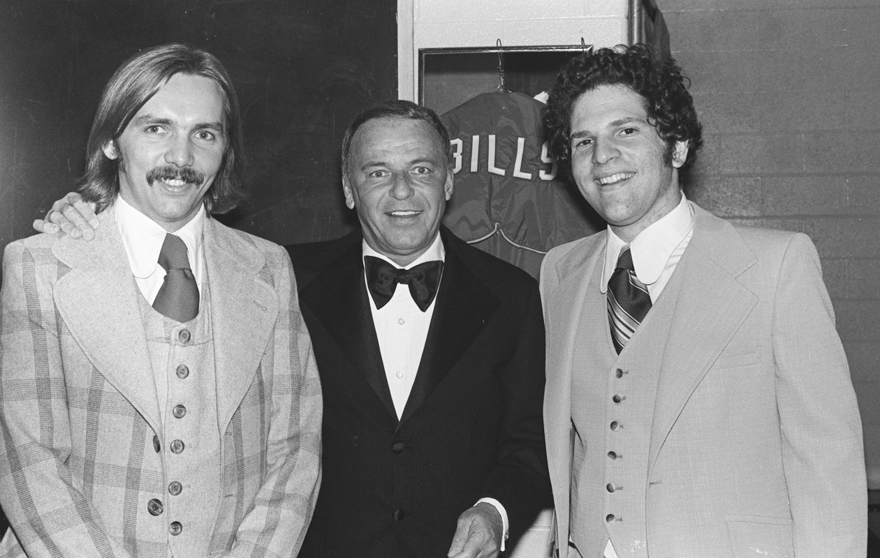 "Harvey Weinstein, right, is shown with Frank Sinatra and Weinstein business partner Horace ""Corky"" Burger in Buffalo in October 1974. (Photo by Mickey Osterreicher)"