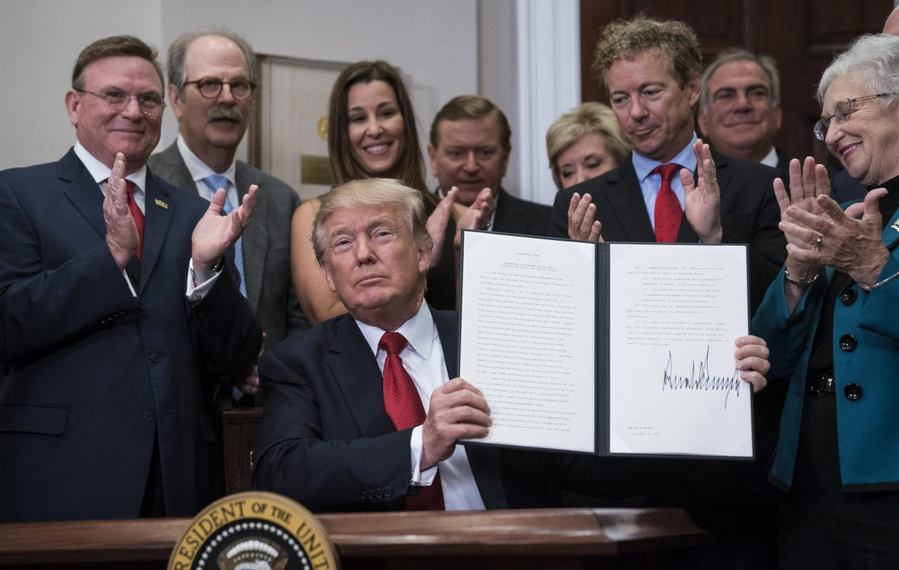 President Trump signs an executive order on health care at the White House Thursday. (Photo by Jabin Botsford/The Washington Post)