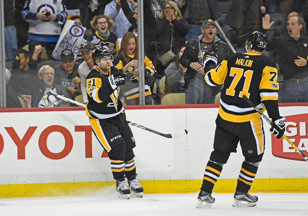 Evgeni Malkin and PPG Paints Arena fans celebrate Phil Kessel's overtime goal that gave Pittsburgh a win Thursday over Winnipeg (Getty Images).