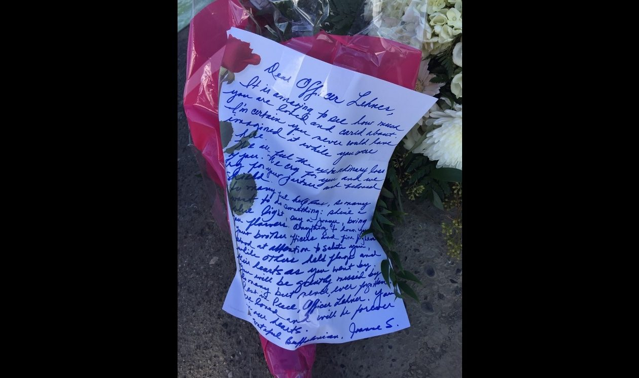 A handwritten letter to Officer Craig Lehner is part of a makeshift memorial at Broderick Park in Buffalo. (Aaron Besecker/Buffalo News)