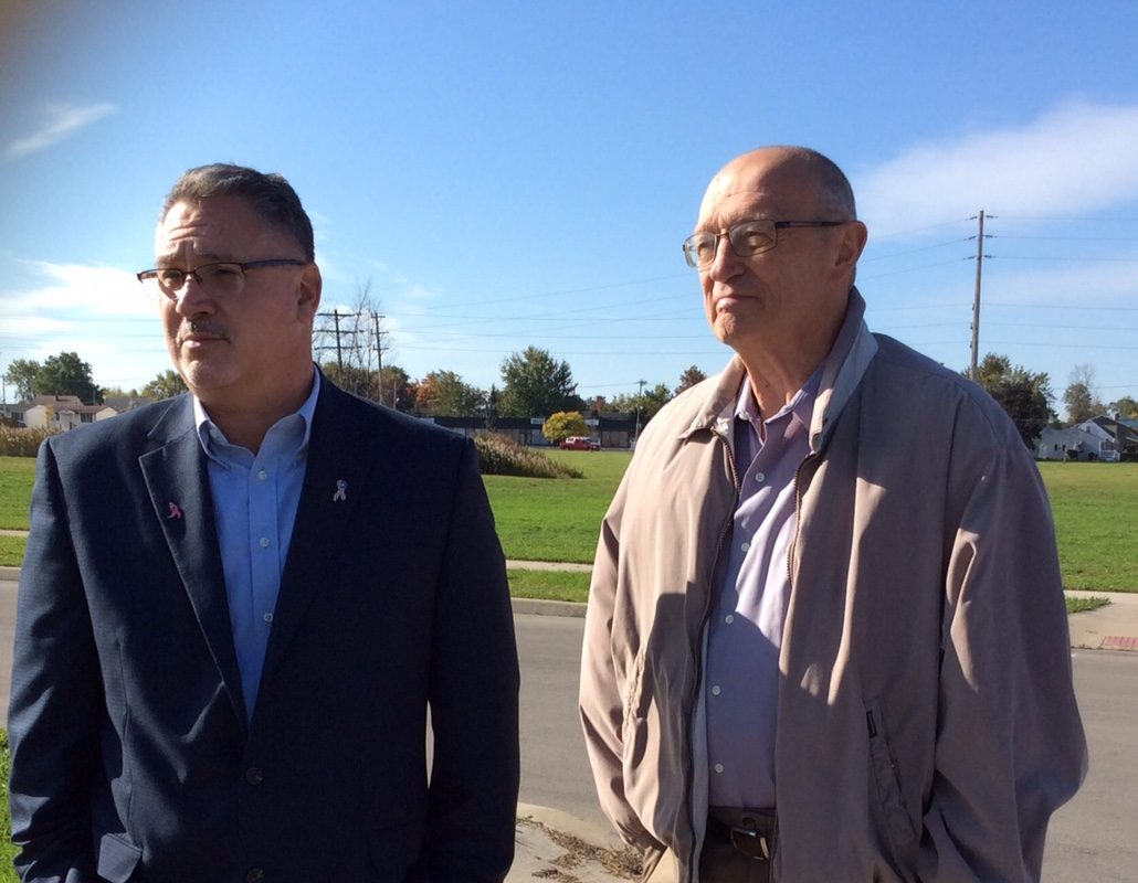 Councilman Tim Toth, left, campaigning for mayor and former Sabre Don Luce discuss plans for a multi-use center