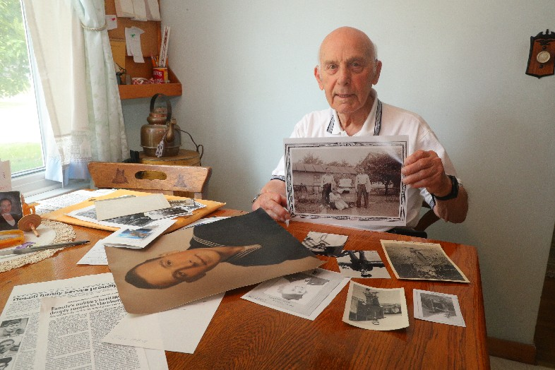 World War II Navy aviator John N. Rosati displays photos of his six brothers, all of whom served and two of whom gave their lives. (John Hickey/Buffalo News)