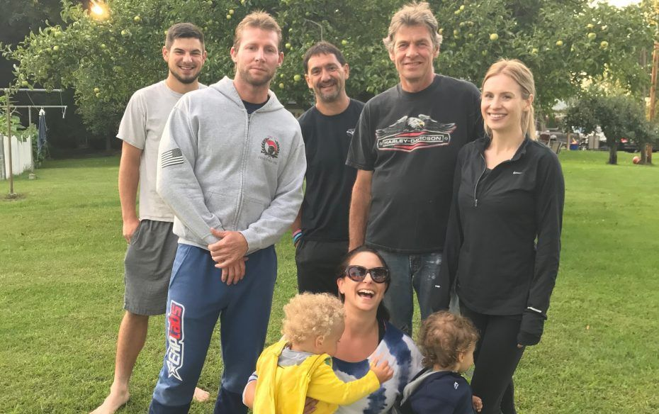 Craig Lehner (standing, second from left) with his summer volleyball team in Akron: high school classmates Abigal Eckerson Estevez (front) with twin sons, Cruz and Renzo; standing, left to right, Evan Erickson, Lehner, Danny Erickson, Bill Erickson and Sadie Glenn. Glenn and Estevez were high school classmates of Lehner's in Akron. (Photo courtesy of Abigail Eckerson Estevez)