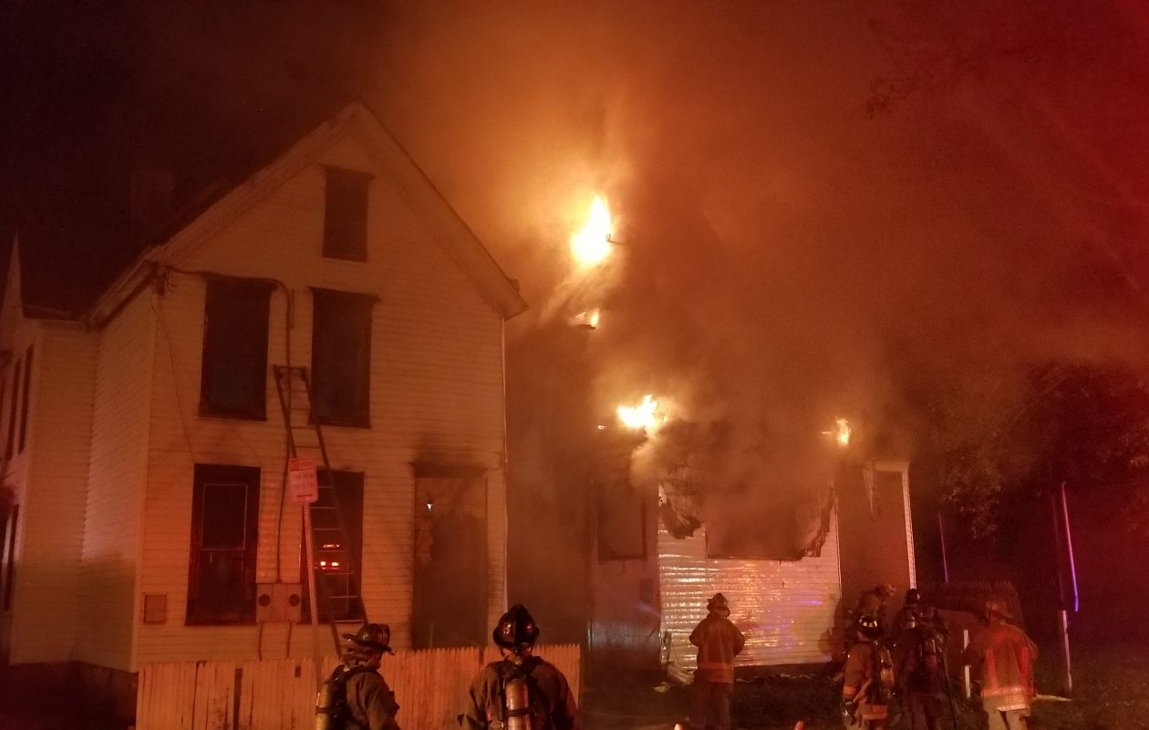 Firefighters battle a blaze at a vacant Watson Street house early Friday. (David F.Kazmierczak/Special to The News)