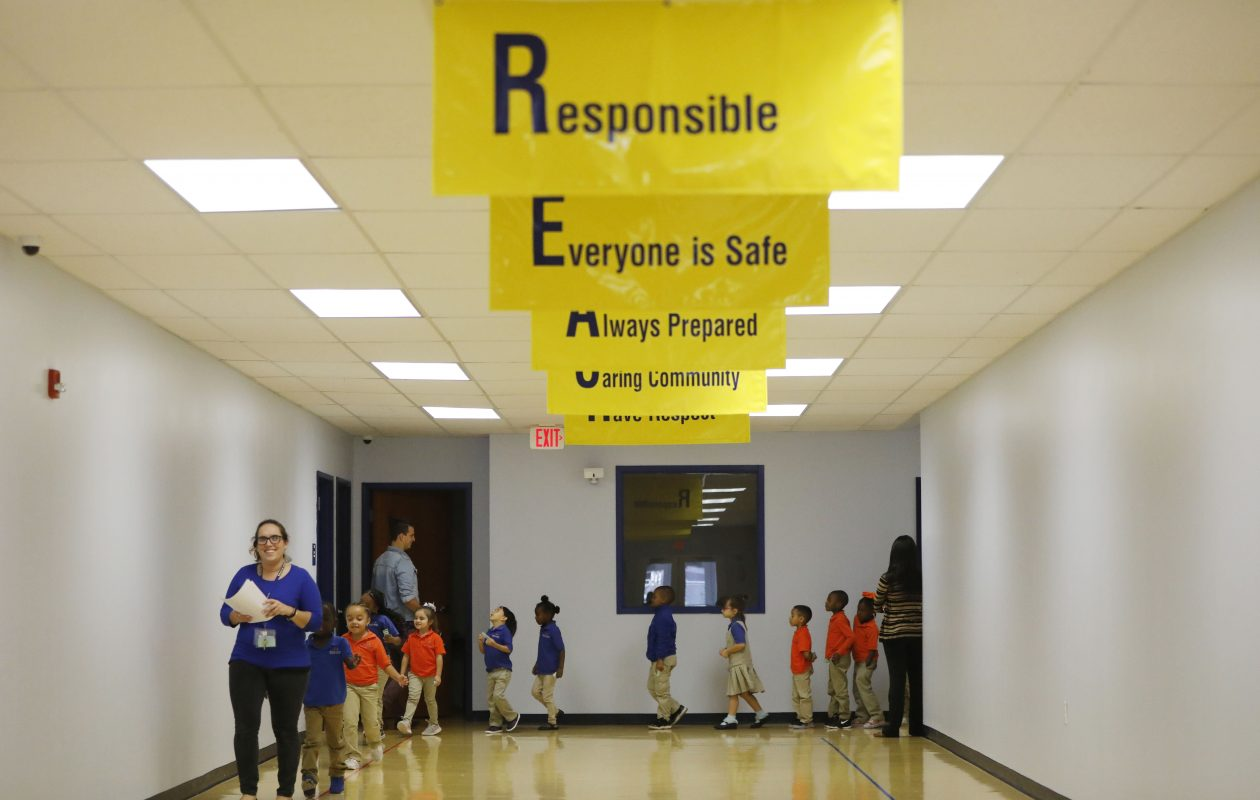 Teacher Anna Chiavaroli leads her kindergarten class down the hallway at REACH Academy Charter School which opened in September.  (Derek Gee/Buffalo News)