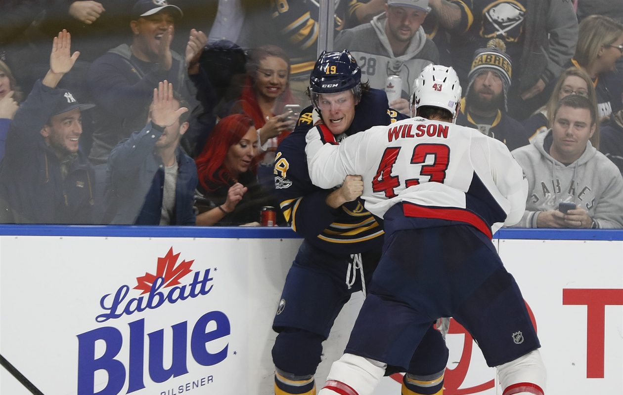 The Sabres' Jake McCabe went after Washington's Tom Wilson following a big hit. (Mark Mulville/Buffalo News)