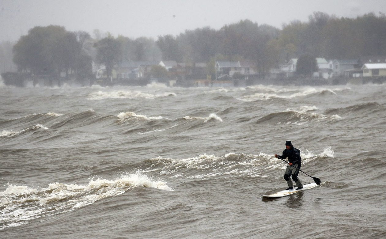 Tuesday's dreary weather didn't keep Matt Domanowski of Hamburg from having some fun on Lake Erie off Hamburg Town Park. (Derek Gee/Buffalo News)