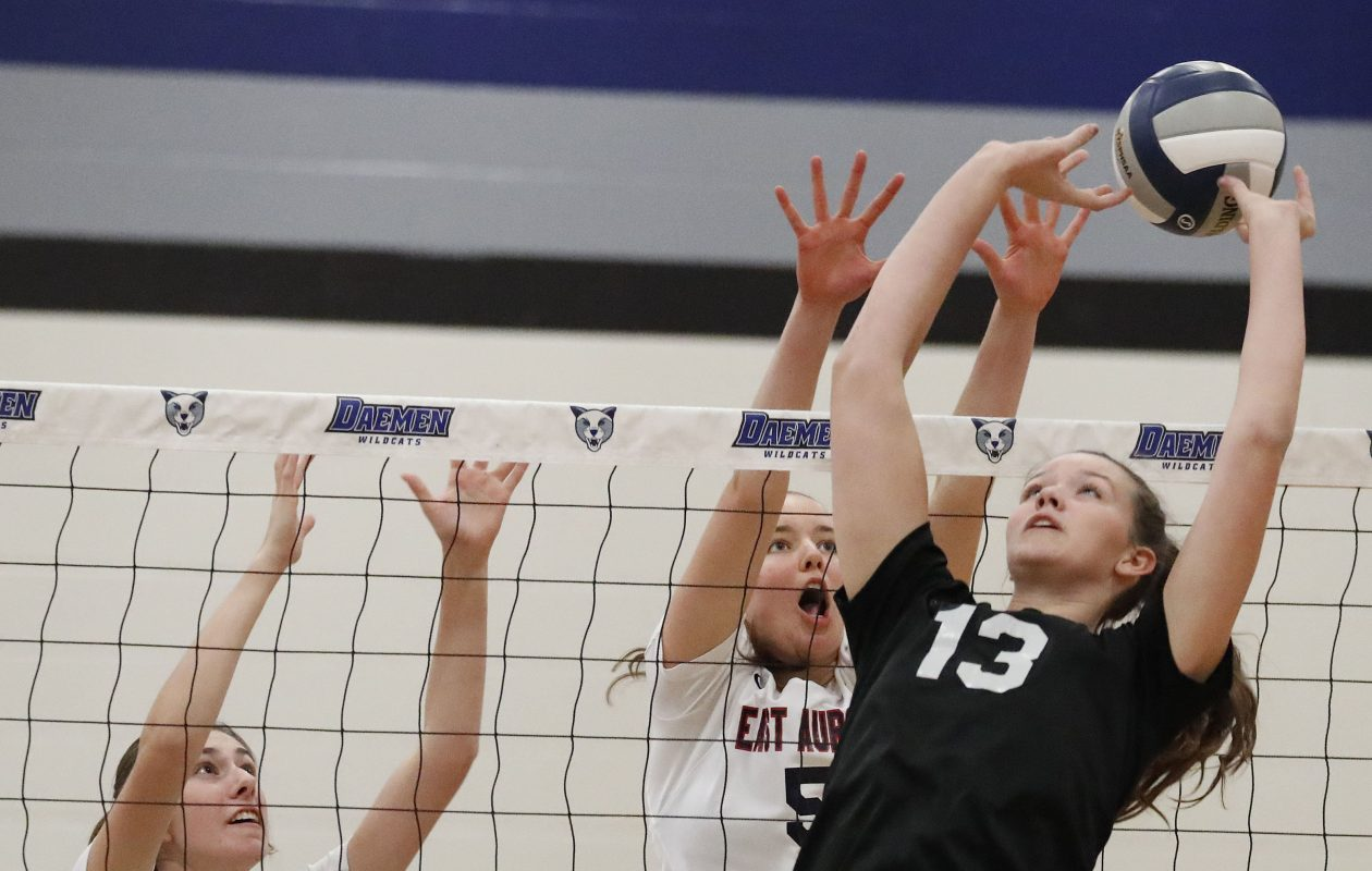 East Aurora's Olivia Covington, left, and Maddie McLaughlin, center, try to block a set by Maryvale's Julia Carter in the Class B-1 final at Daemen College. The Blue Hens repeated as champs with a three-set win. (Mark Mulville/Buffalo News)