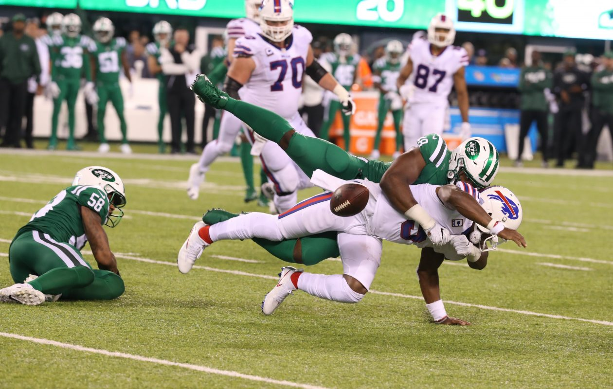New York Jets outside linebacker Jordan Jenkins strip-sacks Buffalo Bills quarterback Tyrod Taylor in the fourth quarter. (James P. McCoy/Buffalo News)