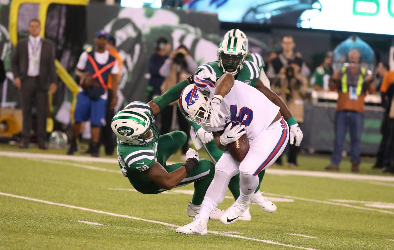 The Jets bring down Bills fullback Mike Tolbert. (James P. McCoy/News file photo)
