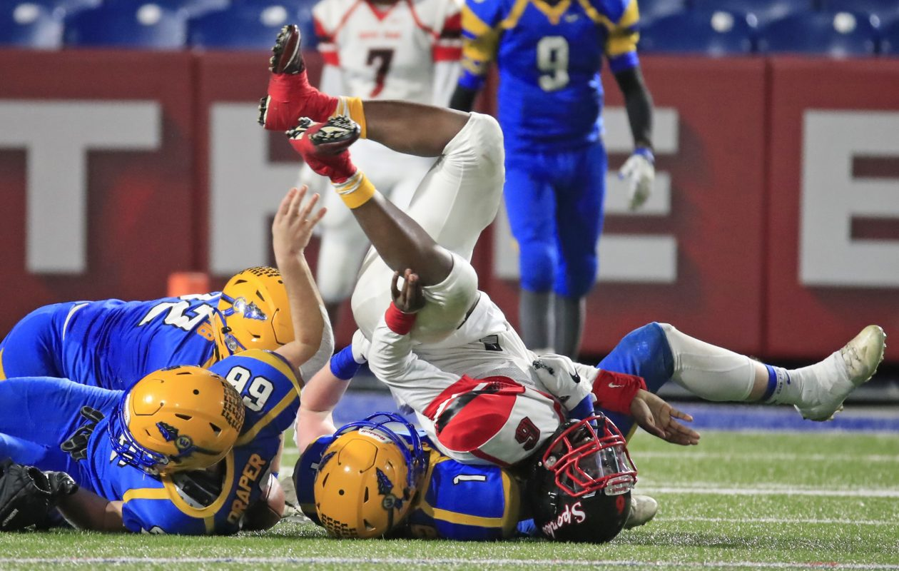 West Seneca West's Liam Scheuer (1) tackles South Park quarterback Deabeyon Humphrey during the Section VI final. Scheuer has eight sacks on the season.  (Harry Scull Jr./ Buffalo News)