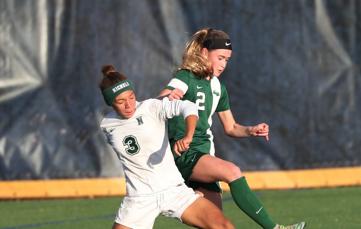 Marisa Warren, of Nichols, left and Brigid Molloy, of Nardin fight over the ball. (Sharon Cantillon/Buffalo News)