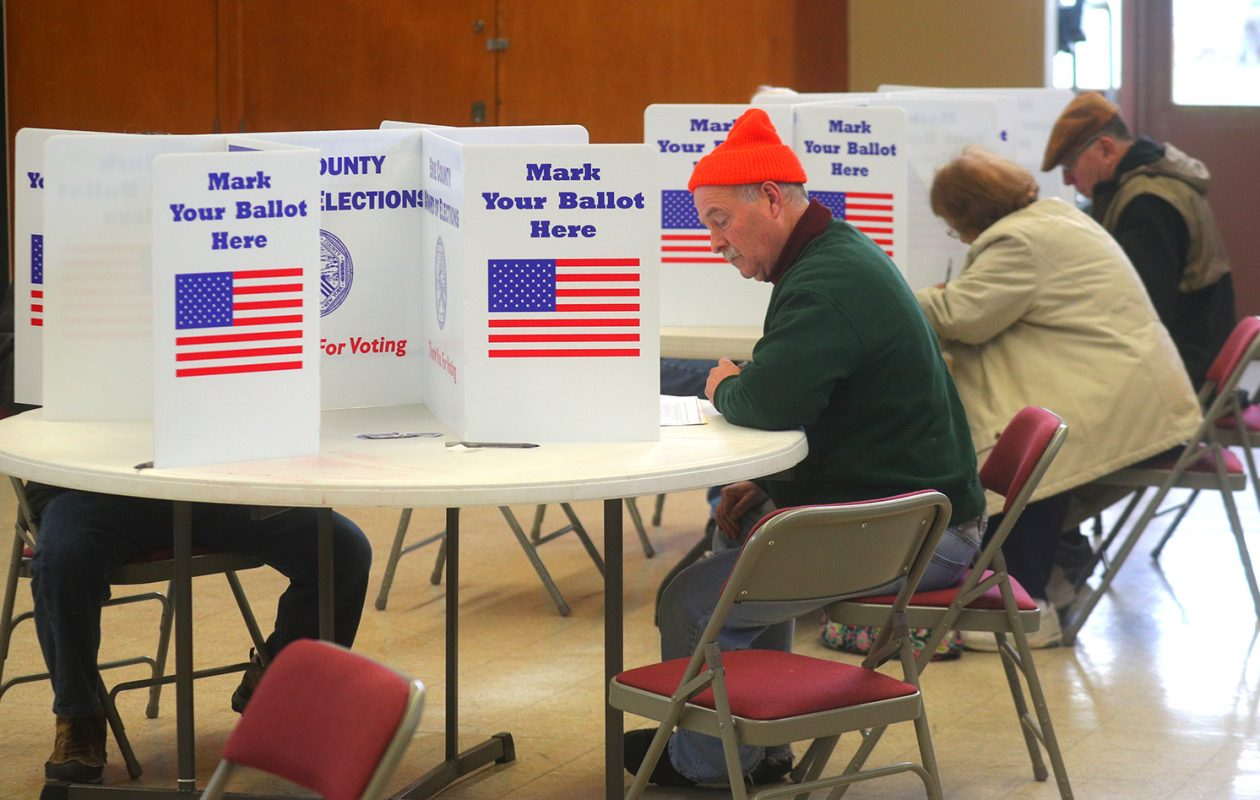 Amherst voter Harlan Berman, left, fills in his ballot at Trinity United Methodist Church in Amherst on Nov. 7. (John Hickey/Buffalo News)