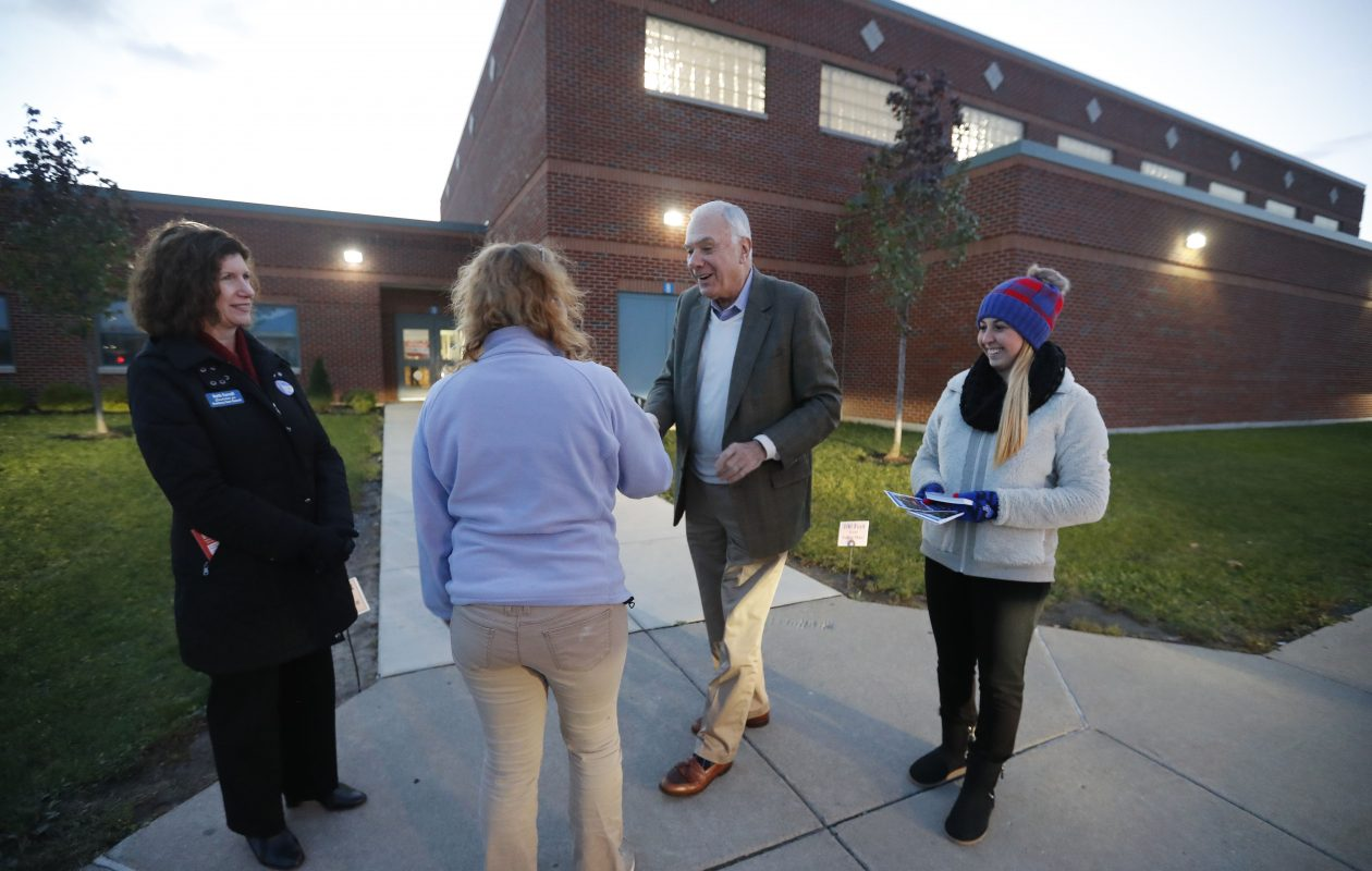 Hamburg Supervisor-elect Jim Shaw and town Councilwoman-elect Beth Farrell, left, greet voters outside of the Hamburg Senior Center Tuesday. (Mark Mulville/Buffalo News)