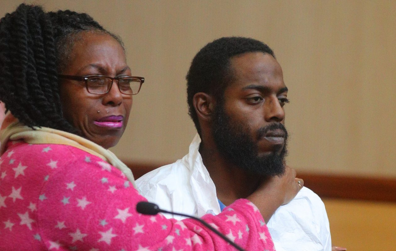 Viola Green hugs her son, Travis Green, as he was arraigned on felony charges, including attempted murder, on Nov. 15, 2017 in Cheektowaga Town Court after police allege he shot a man outside a Dollar General store in Cheektowaga. (John Hickey/Buffalo News)
