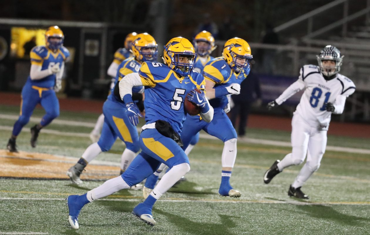 Juston Johnson returns a punt 67 yards for a touchdown in West Seneca West's 42-6 state semifinal win at Union-Endicott High School Friday night. (James P. McCoy/Buffalo News)