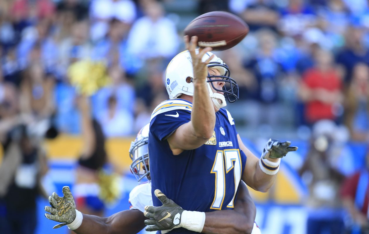 Buffalo Bills Jerry Hughes hits Los Angeles Chargers quarterback Phillip Rivers during second quarter action at the StubHub Center on Sunday, Nov. 19, 2017. (Harry Scull Jr./ Buffalo News)